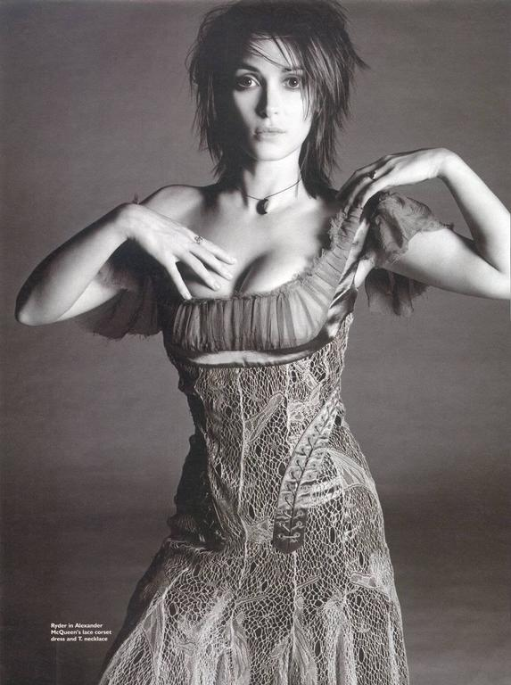 "An Alexander McQueen corset cocktail dress from the Autumn/Winter 2002 ""SUPERCALIFRAGILISTIC"" collection. The dress features a ruched bust with flutter cap-sleeves, lace-up detailing contouring the hips, boned bodice and spider-web like lace with"