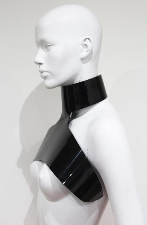 An Yves Saint Laurent by Stefano Pilati harness choker from the Autumn/Winter 2006 collection. The choker wraps around the neck and under the arms just above the bust. 