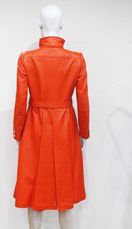 Women's Courreges orange vinyl coat dress, c. 1970