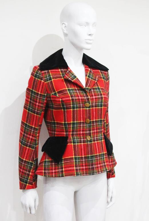 A Vivienne Westwood tailored jacket from the Autumn/Winter 1994 collection. The jacket features pointed black velvet lapels and pocket flaps. 
