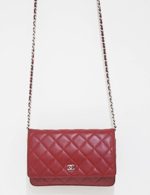 The Chanel WOC (wallet on chain) bag in red caviar leather with classic  Chanel cb860c980f2ef