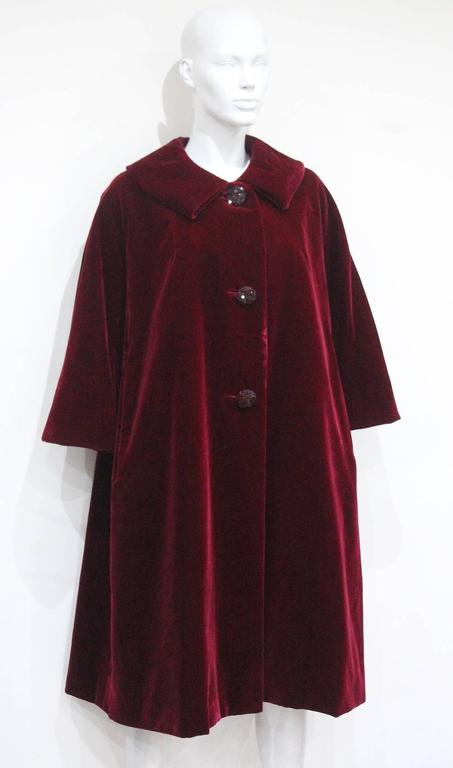 One of a Kind is proud to offer a Haute Couture Autumn/Winter 1956 extremely rare silk velvet opera coat by the house of Christian Dior.   This evening opera coat oozes elegance with great simplicity and cut of a swing style. The coat is made of