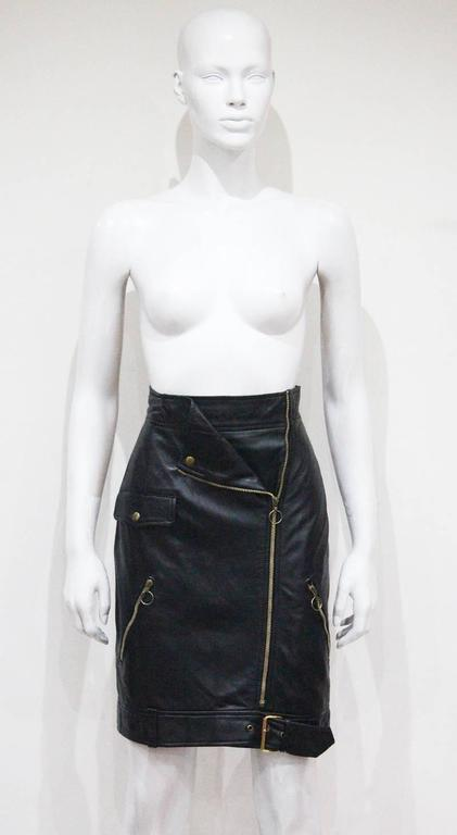 A Moschino black leather high waisted pencil skirt in the style of a classic biker jacket. 