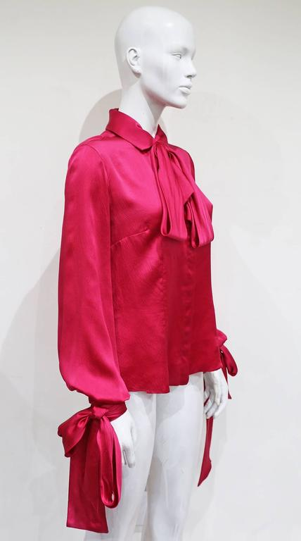 Alexander McQueen evening blouse in fuchsia pink silk with bishop sleeves and three extra long ties on the collar and cuffs. 