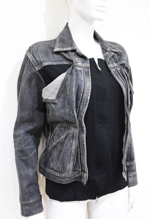 Yohji Yamamoto distressed deconstructed denim jacket, circa 1990s. The jacket features an attached inside black cardigan with a double zipper.