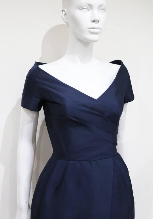 An absolutely beautiful couture Rose Bertin silk cocktail dress, circa 1950s. The dress has an off-the-shoulder design with pleating across the bust and waist. Inside is a boned corset giving the dress a structured silhouette. Rose Bertin was a