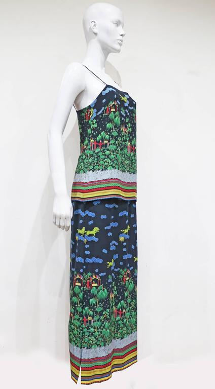 A beautiful silk summer dress by Murray Arbeid London, the dress features an illustration Oriental print throughout.   Murray Arbeid was a British fashion designer, known for his evening wear. His notable clients included Princess Diana and