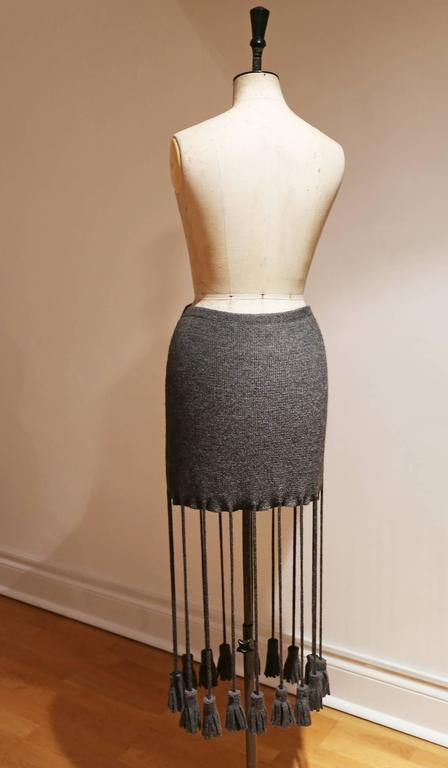 Knitted button up skirt with extra long tassels, c. 1990s 4