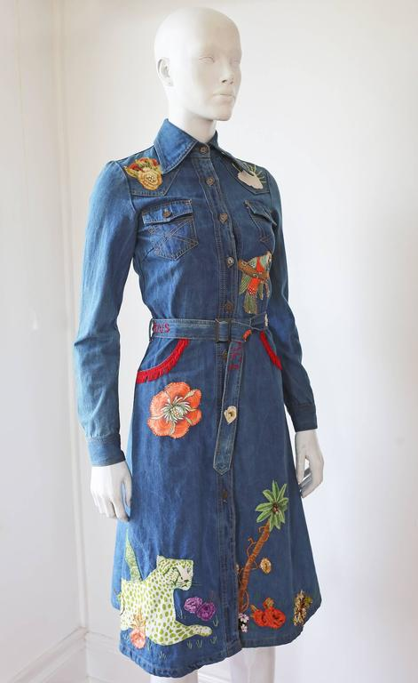 Extremely rare and collectible Peter Golding denim dress from the ACE store on London's King's Road Chelsea in 1974. The dress features, western style fringed pockets, hand sewn patchwork jungle themed imagery all over and embroidered 'ACE JUNGLE