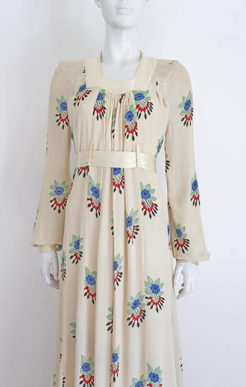 A very rare Ossie Clark summer evening dress in collaboration with his former wife, textile designer Celia Birtwell. The dress has an ivory satin collar which fastens at the rear with two fabric buttons, bishop sleeves with ivory satin cuffs,
