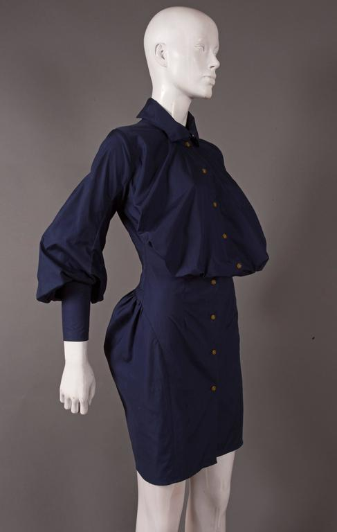 Vivienne Westwood navy cotton shirt dress, circa 1990s. The dress features a balloon like chest, high neck collar, bishop sleeves and a bustle.