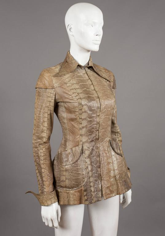 """Rare Ossie Clark snakeskin jacket, circa 1967. Peplum waist, metal zip closure, pointed collar, turn over pointed cuff, two front pockets and shoulder caps.   Bust 34""""  Waist 26.5"""""""