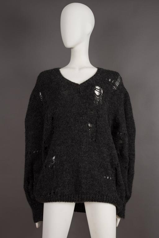 Extremely rare COMME des GARCONS oversized knitted sweater decorated with randomly placed holes, circa 1982. 