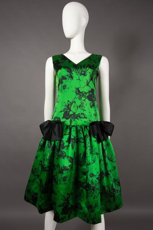 Exquisite and extremely rare Paul Daunay cocktail dress, circa 1952-57. The dress is fabricated in a fine silk with an abstract floral print. Drop waist with full pleated skirt, fitted bodice, low back, v-neck and metal zip closure. 