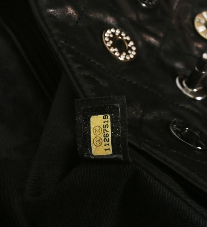 Chanel black quilted flap bag with decorative Chanel eyelets, circa 2007 8
