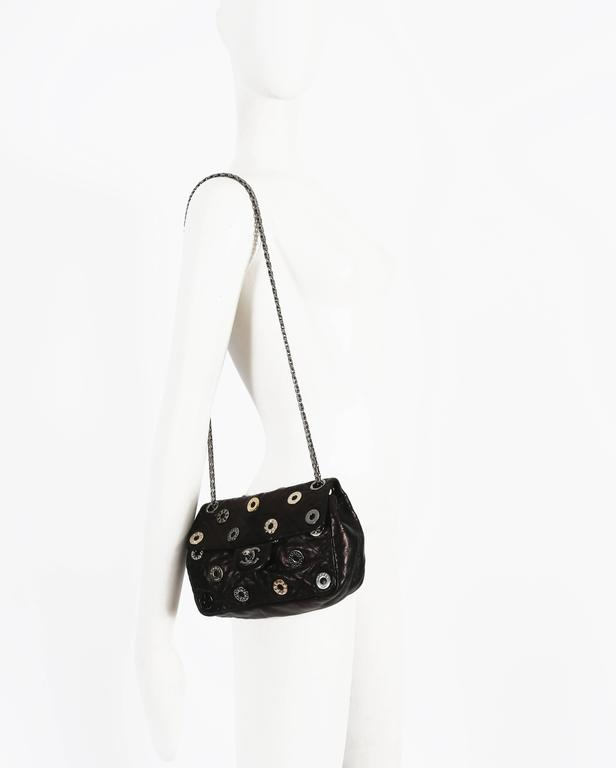 Chanel black quilted flap bag with decorative Chanel eyelets, circa 2007 5