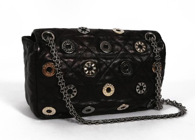 Chanel black quilted flap bag with decorative Chanel eyelets, circa 2007 6
