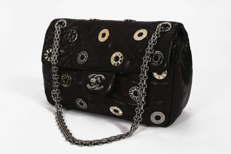 Chanel black quilted flap bag with decorative Chanel eyelets, circa 2007 3