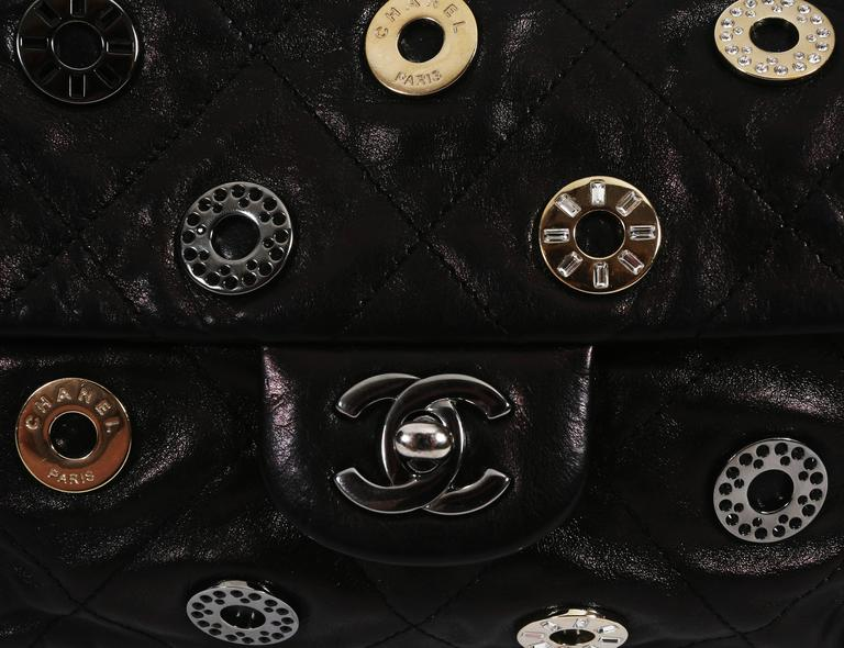 Chanel black quilted flap bag with decorative Chanel eyelets, circa 2007 4