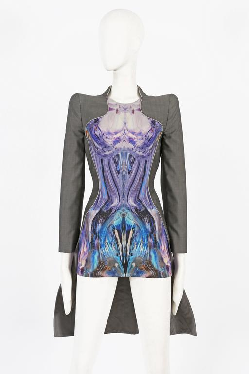 Extremely rare Alexander McQueen mini dress from his last collection 'Plato's Atlantis' Spring/Summer 2010. The dress features sharp tailoring throughout, padded shoulders, metallic piping and a digitally mirrored print of Jellyfish on a knitted