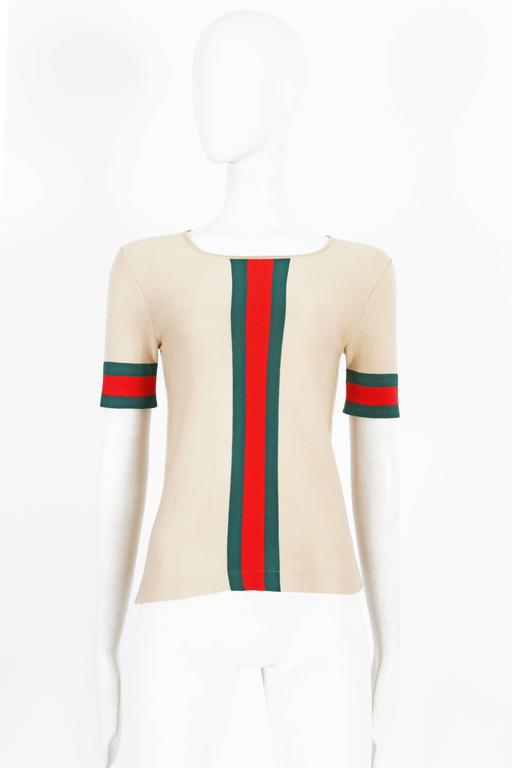 A rare knitted 1970s Gucci t-shirt featuring the iconic green and red stripe down the center front and cuffs.