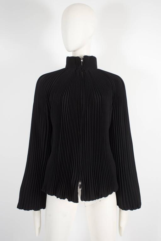 Alexander McQueen evening jacket, pre-fall 2004. The jacket is constructed in accordion pleated wool crepe throughout, features balloon sleeves, silk lining and double-slide zip closure.