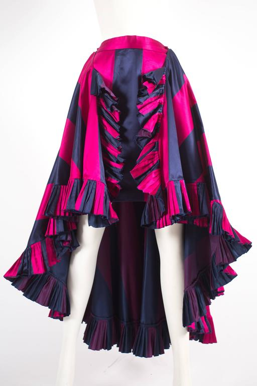 Christian Dior by Gianfranco Ferré flamenco skirt, autumn-winter 1993. The skirt is constructed in a navy and fuchsia striped silk and features a detachable train with a knife-pleated hem, silk lining, and button closures.