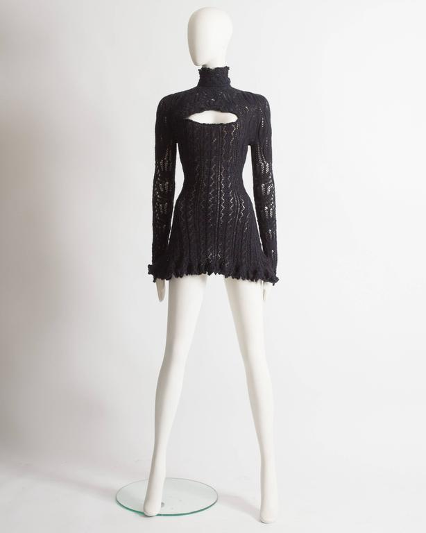 Rare Vivienne Westwood crochet knit mini dress. Internal corset with boning, scalloped hem on the skirt, and collar, cutout on the bust and zip closure at the rear.  Autumn-Winter 1993