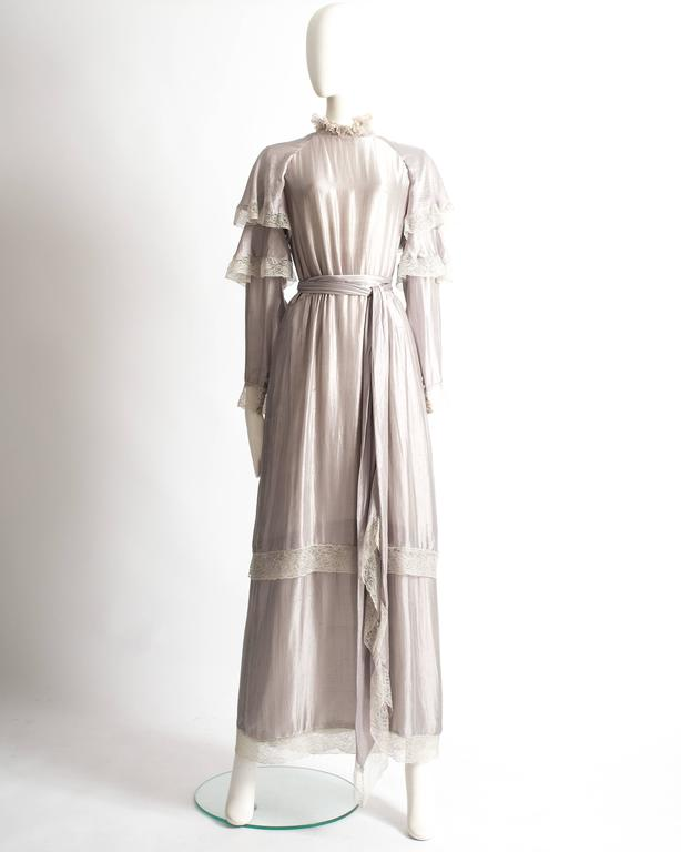 Tan Giudicelli raw silk evening dress with ivory lace trimmings throughout and button closure at the back.   Circa 1970s