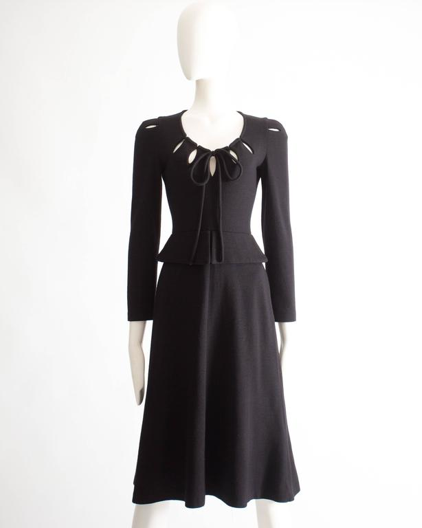 Ossie Clark black wool mid-length dress with cut-outs on the collar and shoulders with string fastening on the bust.
