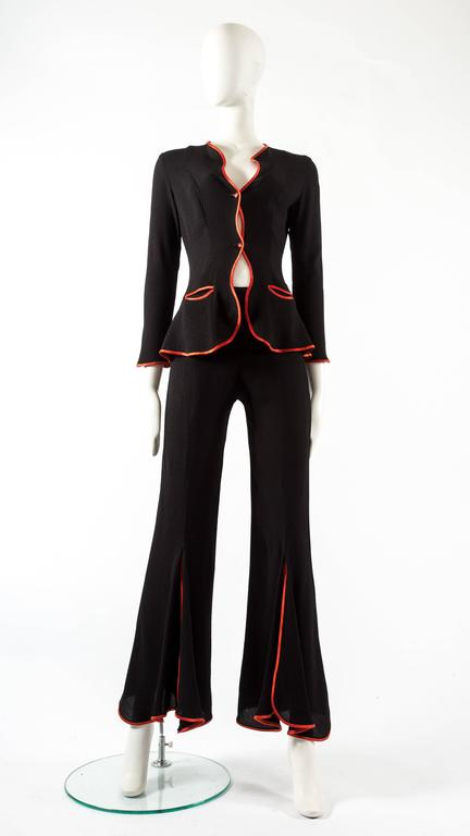 Ossie Clark 1970 black moss crepe 'Judy' trouser suit, with undulating borders piped in red satin.