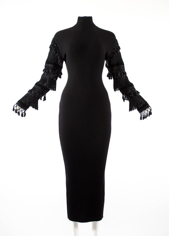 Jean Paul Gaultier Autumn-Winter 1985 black rib knit evening dress   - turtle neck - decorative velvet, sequins and tassels on sleeve - zip fastening at the neck  - Fr 40 - It 44 - UK 12