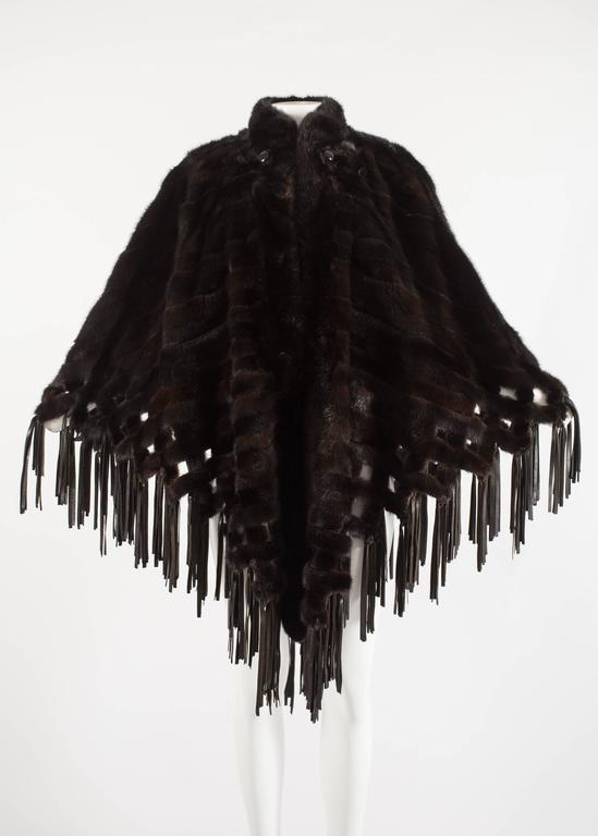 Christian Dior 1970s brown mink poncho with lambskin leather tassels with hook and eye closures and two large buttons.