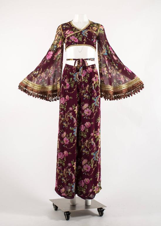 Dolce & Gabbana Spring-Summer 1994 silk chiffon gypsy pant suit   - cropped wrap blouse with bell sleeves, gold braid trim and tassels  - low cut wide leg pants