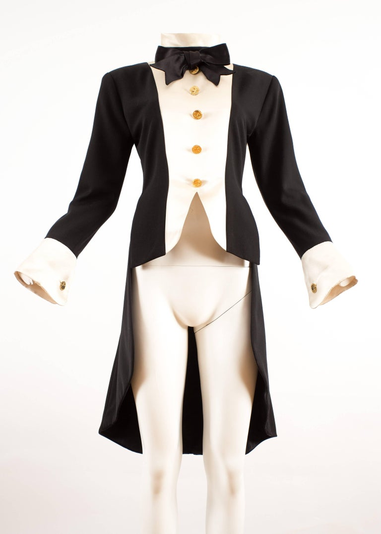 Chanel 1980s black silk evening tailcoat   - gold-tone buttons - ivory coloured silk  - black silk bow tie  - zip fastening