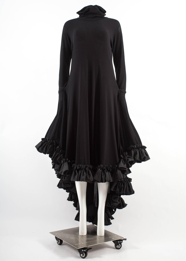 Yohji Yamamoto Spring-Summer 1999 black cotton evening dress with pinstripe ruffled hem, two side pockets and turtle neck.   From the 'Transformative Wedding Collection'