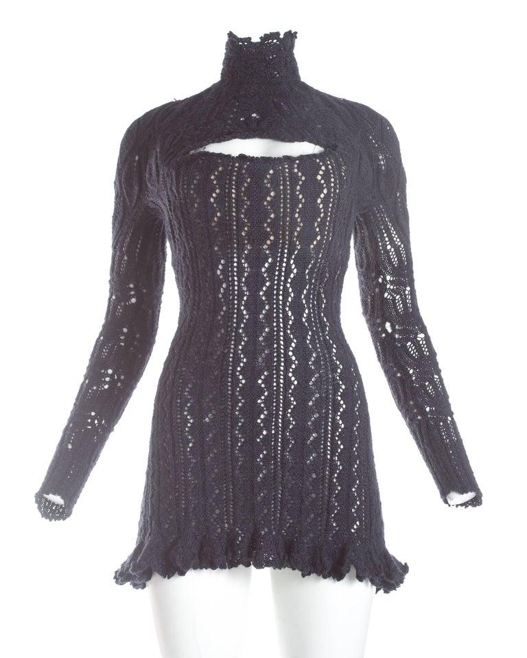 - Internal boned corset  - Cleavage cut-out - Zip fastening  Autumn-Winter 1993