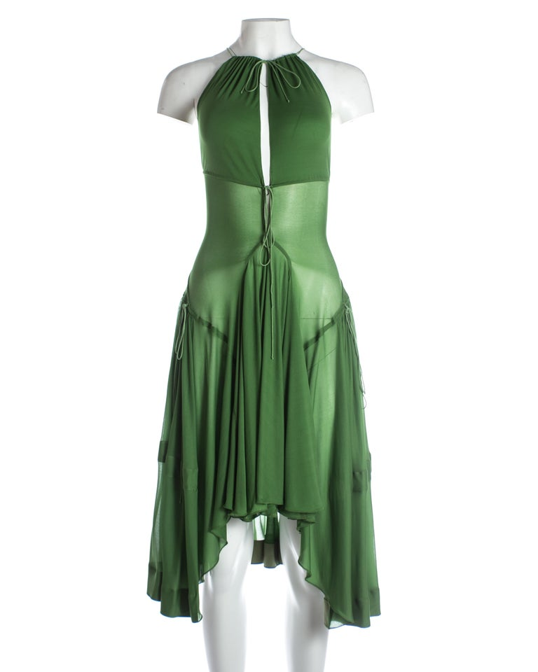 - peek-a-boo cleavage  - open back with lace up fastening  - full pleated skirt with irregular hem line   c. 2000-2009