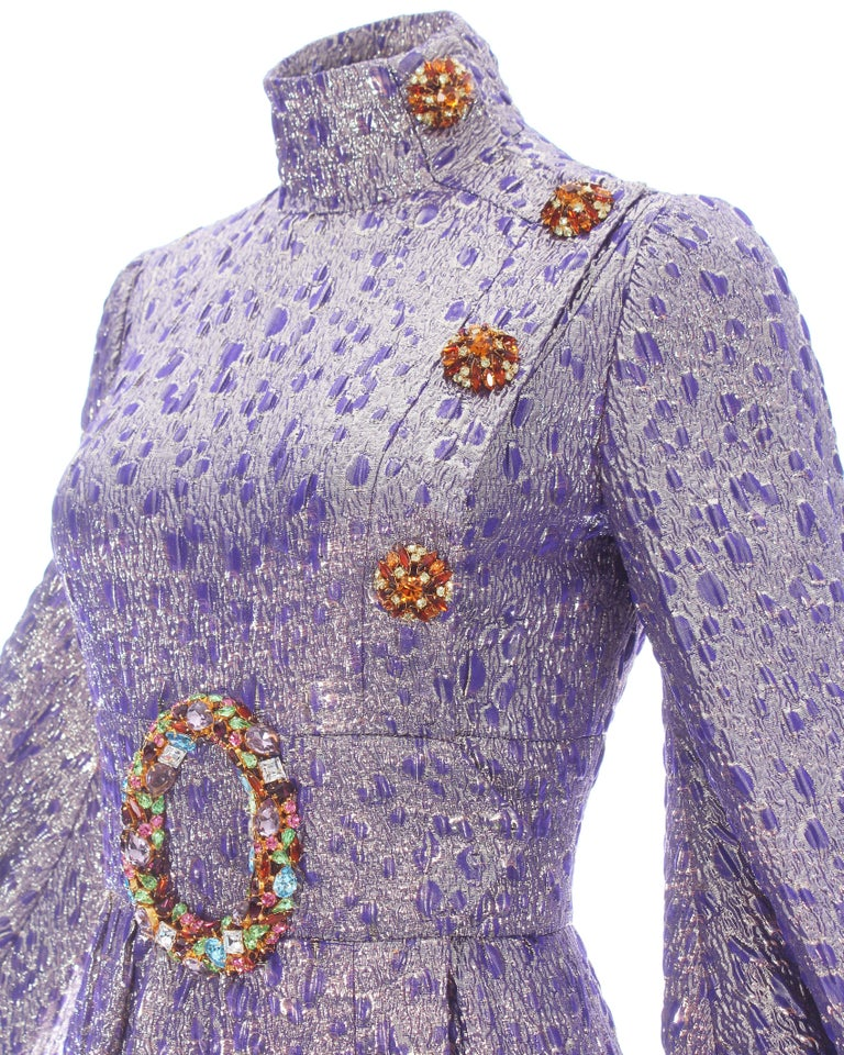 - Poet sleeves  - Jewel encrusted buttons and belt buckle broach  - Silk lining   Haute Couture, Autumn-Winter 2005