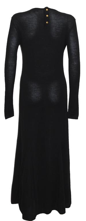Autumn/Winter 1993  A black full length knitted maxi dress with long fitted sleeves and 3 gold tone button closure at rear.   An early example of Tom Fords designs for the house Gucci.  Size Small