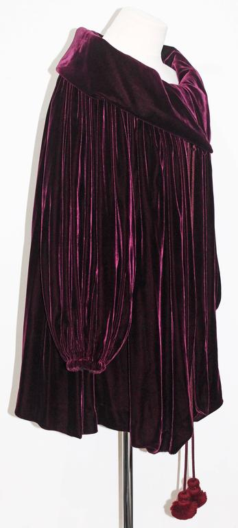 An exceptional silk velvet opera coat by Gianfranco Ferré for Christian Dior designed in the early 1990s. The coat has long beaded rope tassels.