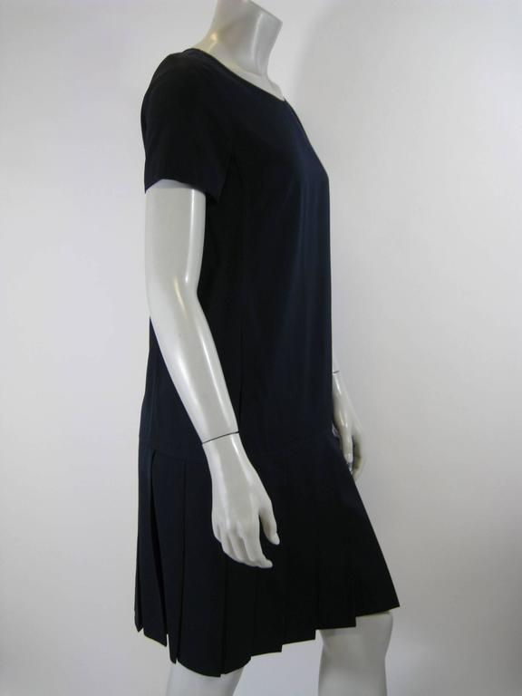 Vintage Andre Courreges navy blue dress. Drop waist with knife pleated skirt. Darted waist. Side slit pockets. Back zipper. Fully lined. Refined wool. No size tag found.  Bust: 36