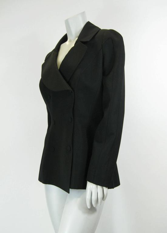 Vintage Thierry Mugler black shaped jacket. 80's does 40's style. Double breasted with hidden snap closures. Deep neckline. Slit pockets. Lined. No size tag.  Bust: 42