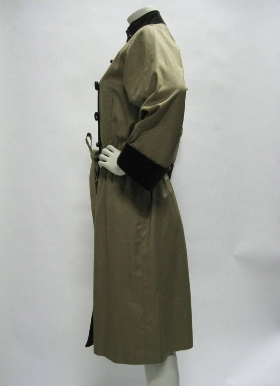 Yves Saint Laurent tan and brown trench coat. Vintage circa 1980's. Cotton outer with contrasting corduroy trim. Mock collar. Elasticized waist with self belt. Toggle buttons. Side pockets. Fully lined.  Bust: 42