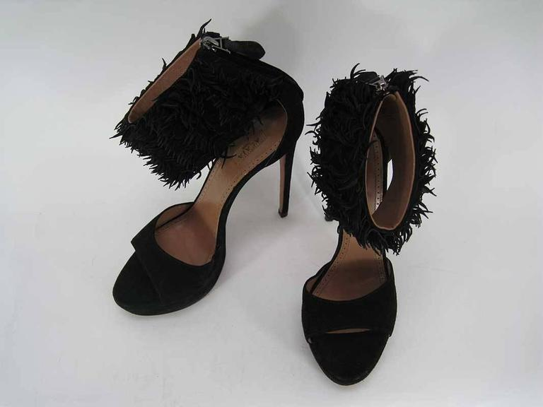 ALAIA high heeled shoes in black suede. These are in excellent, lightly-used condition.  Made in Italy.  These are marked a size 39 1/2  MEASUREMENTS: Heel Height: 5 5/8