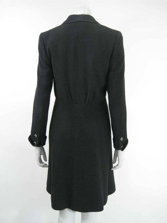 This Chanel coat in 100% silk has quilted lapels and a metal CC logo on one sleeve.   The coat is tagged a size 38. Made in France.  Measurements:  Shoulders: 14.75