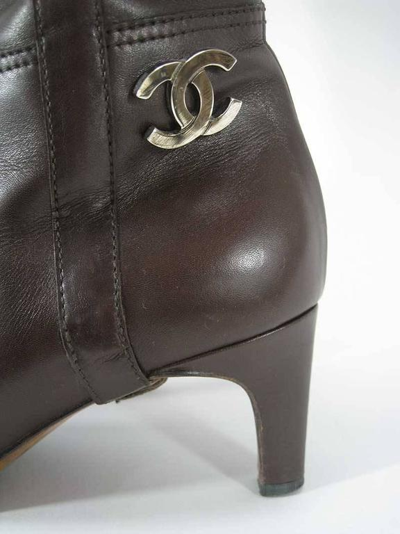Women's Chanel Tall Brown and Black Leather Boots  For Sale