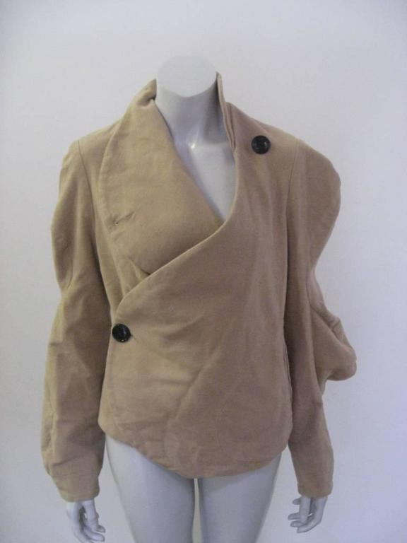 Vivienne Westwood Anglomania jacket in brown cotton.   The jacket is in excellent pre-owned condition, lightly used.  The jacket is tagged a size US 6.  Measurements: Shoulders: 16