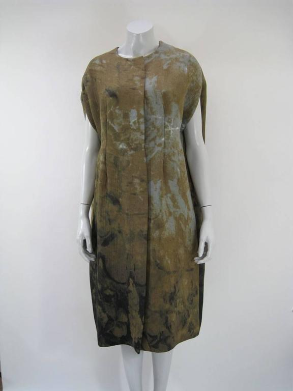 Sleeveless tie-dye / rust dye coat by Marni.  Textured moss green and blue grey patterns.  Hourglass shape. Mid calf length.  Viscose and Silk.  Acetate and Rayon Lined.  Tagged a size 42.  This is in excellent pre-owned condition with no holes,