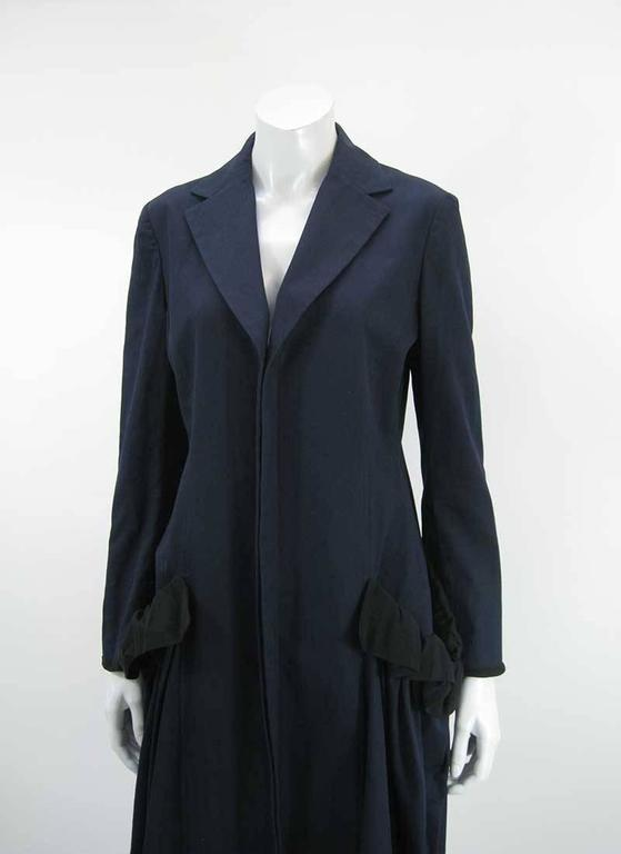 Dark navy blue coat with lovely draping and oversize front pouch pockets by Yohji Yamamoto, +Noir collection.  Mid calf length.  Cotton and Silk.   Made in Japan.  Tagged a size 2.  This is in excellent pre-owned condition with no holes, stains or